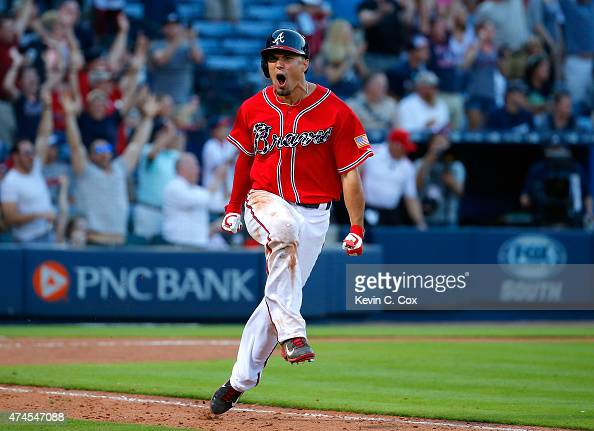 Jace Peterson of the Atlanta Braves reacts after hitting a walkoff RBI single in the 11th inning against the Milwaukee Brewers at Turner Field on May...