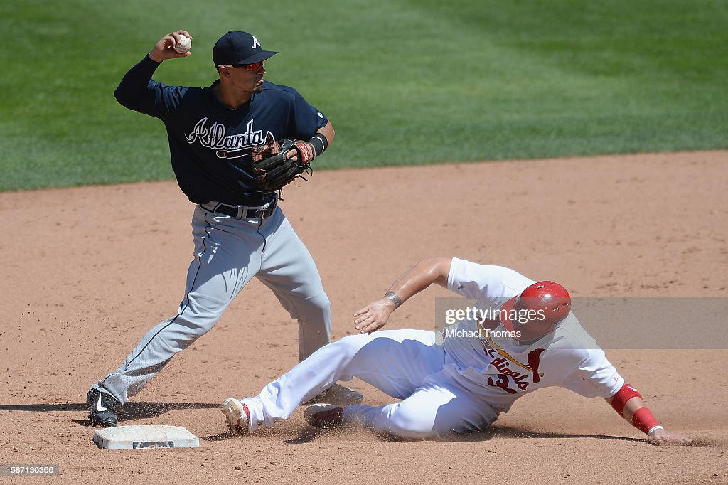 Jace Peterson #8 of the Atlanta Braves turns a double play during a game against the St. Louis Cardinals at Busch Stadium on August 7, 2016 in St. Louis, Missouri.