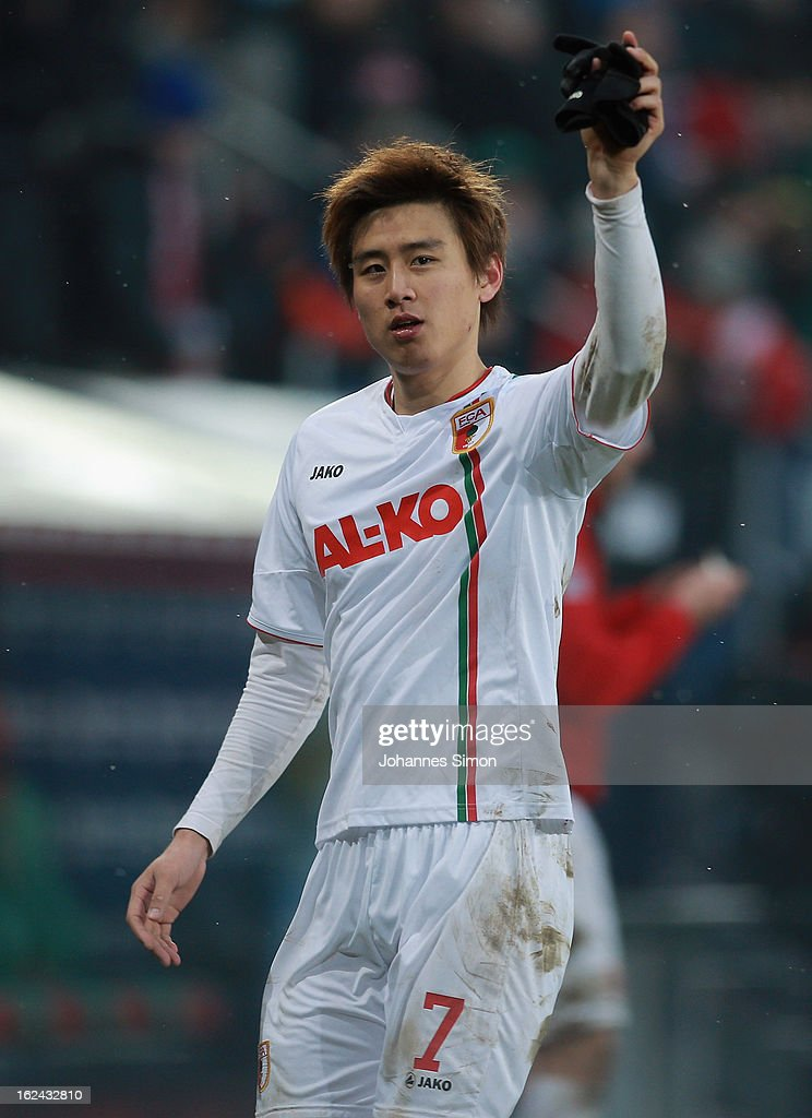 JaCheol Koo celebrates with supporters after winning the Bundesliga match between FC Augsburg and TSG 1899 Hoffenheim at SGL Arena on February 23...