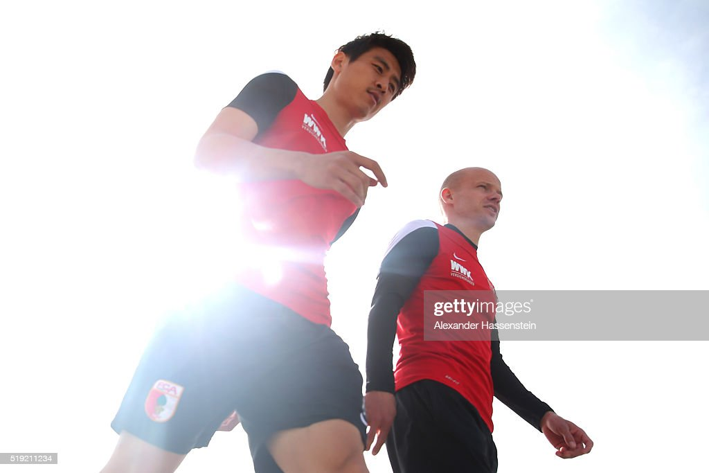 Ja-Cheol Koo (L) of Augsburg arrives for a FC Augsburg Training session at WWK Arena on April 5, 2016 in Augsburg, Germany.