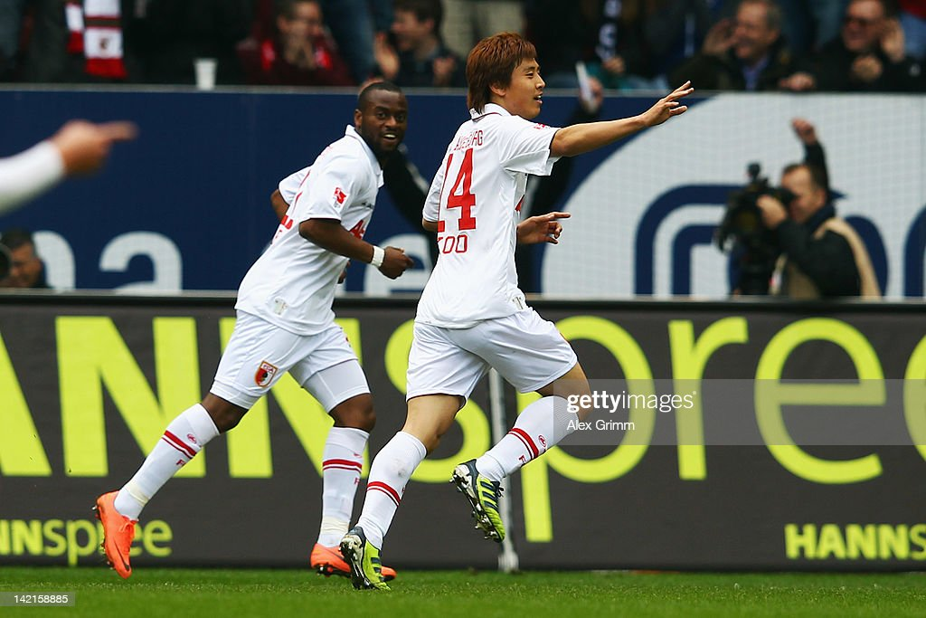 JaCheol Koo of Augsburg celebrates his team's first goal with team mate Nando Rafael during the Bundesliga match between FC Augsburg and 1 FC Koeln...