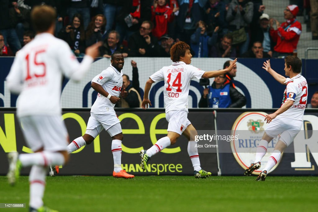 JaCheol Koo of Augsburg celebrates his team's first goal with team mates Sebastian Langkamp Nando Rafael and Paul Verhaegh during the Bundesliga...