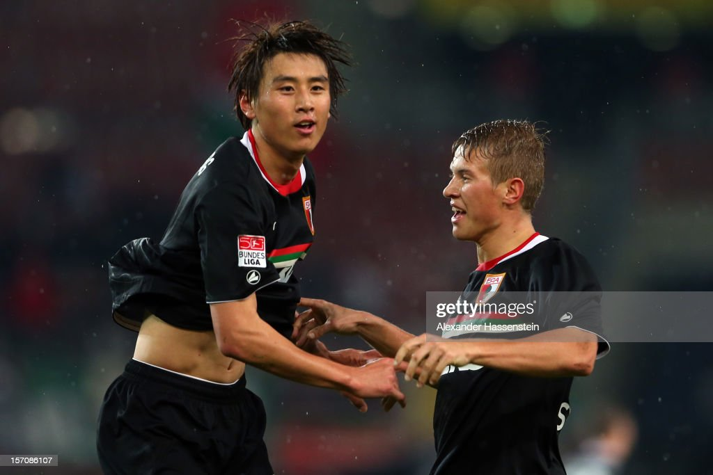 Ja-Cheol Koo (L) of Augsburg celebrates scoring his first team goal with his team mate Matthias Ostrzolek during the Bundesliga match between VfB Stuttgart and FC Augsburg at Mercedes-Benz Arena on November 28, 2012 in Stuttgart, Germany.