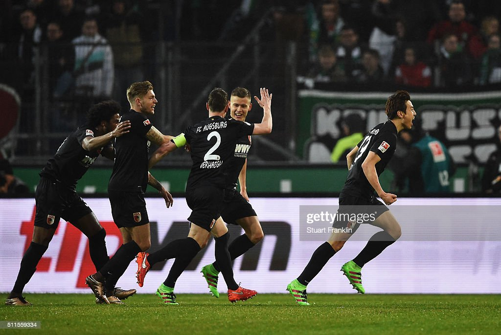JaCheol Koo of Augsburg celebrates scoring his goal during the Bundesliga match between Hannover 96 and FC Augsburg at HDIArena on February 21 2016...