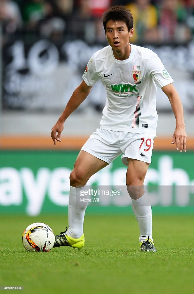 JaCheol Koo of Augsburg controls the ball during the Bundesliga match between FC Augsburg and Hannover 96 at WWK Arena on September 20 2015 in...