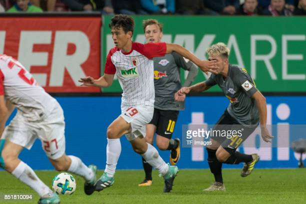 JaCheol Koo of Augsburg controls the ball mit Kevin Kampl of Leipzig during the Bundesliga match between FC Augsburg and RB Leipzig at WWKArena on...
