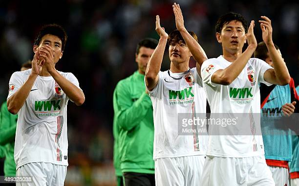 JaCheol Koo of Augsburg JeongHo Hong of Augsburg and DongWon Ji of Augsburg bid goodbye to the fans after the Bundesliga match between FC Augsburg...