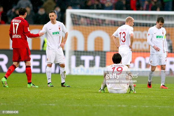 JaCheol Koo of Augsburg reacts after the Bundesliga match between FC Augsburg and Bayer Leverkusen at WWK Arena on March 5 2016 in Augsburg Germany