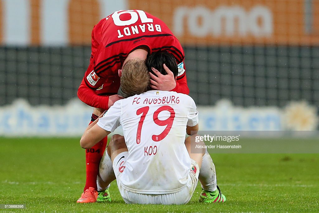 Ja-Cheol Koo (R) of Augsburg reacts with <a gi-track='captionPersonalityLinkClicked' href=/galleries/search?phrase=Julian+Brandt&family=editorial&specificpeople=7840042 ng-click='$event.stopPropagation()'>Julian Brandt</a> of Leverkusen after the Bundesliga match between FC Augsburg and Bayer Leverkusen at WWK Arena on March 5, 2016 in Augsburg, Germany.