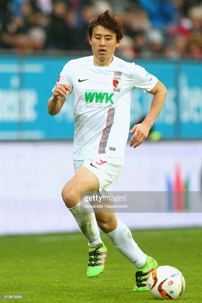 JaCheol Koo of Augsburg runs with the ball during the Bundesliga match between FC Augsburg and Bayer Leverkusen at WWK Arena on March 5 2016 in...