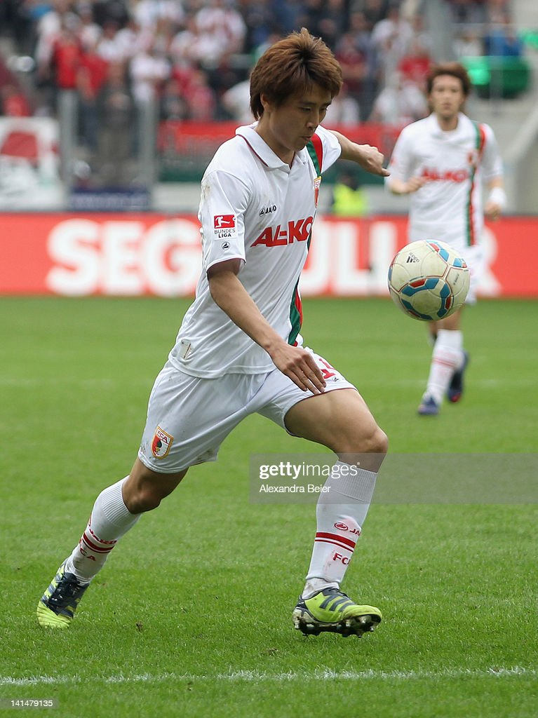JaCheol Koo of Augsburg scores his first goal during the German Bundesliga match between FC Augsburg and FSV Mainz 05 at SGL Arena on March 17 2012...