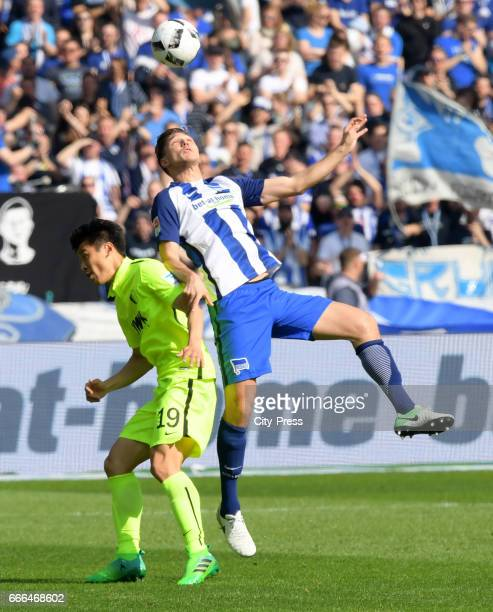 JaCheol Koo of FC Augsburg and Niklas Stark of Hertha BSC during the game between Hertha BSC and FC Augsburg on april 9 2017 in Berlin Germany