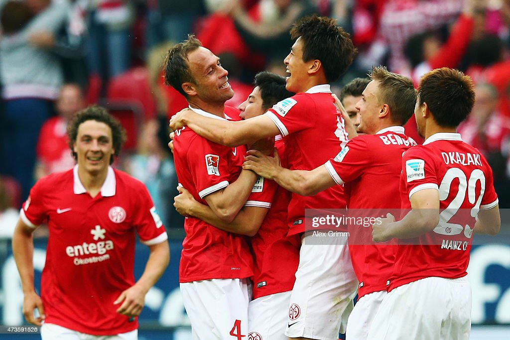 Ja-Cheol Koo (3R) of Mainz celebrates his team's first goal with team mates during the Bundesliga match between 1. FSV Mainz 05 and 1. FC Koeln at Coface Arena on May 16, 2015 in Mainz, Germany.