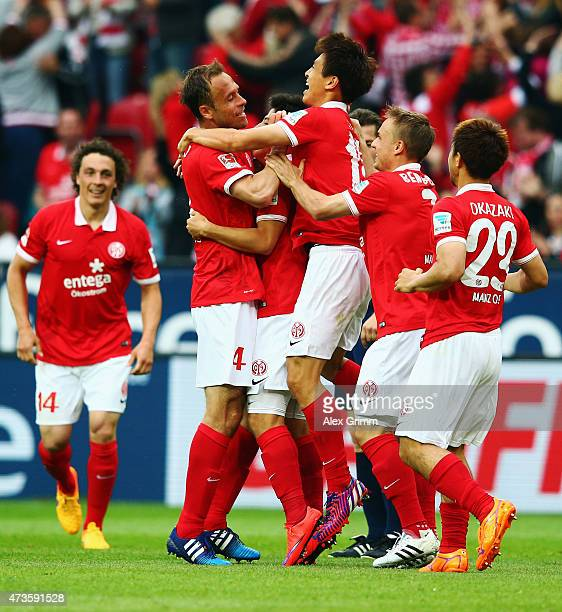 JaCheol Koo of Mainz celebrates his team's first goal with team mates during the Bundesliga match between 1 FSV Mainz 05 and 1 FC Koeln at Coface...