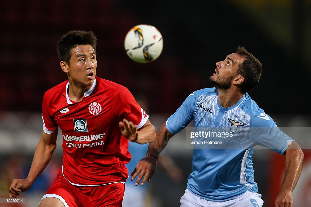 JaCheol Koo of Mainz jumps for a header during the Friendly Match between 1 FSV Mainz 05 and Lazio Roma at Bruchweg Stadion on July 29 2015 in Mainz...
