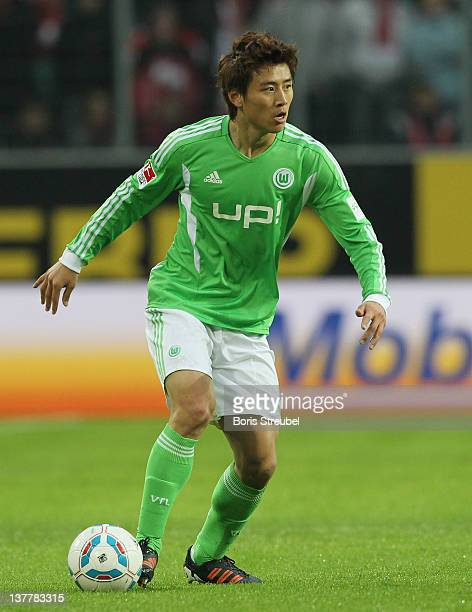 JaCheol Koo of Wolfsburg runs with the ball during the Bundesliga match between VfL Wolfsburg and 1 FC Koeln at Volkswagen Arena on January 21 2012...
