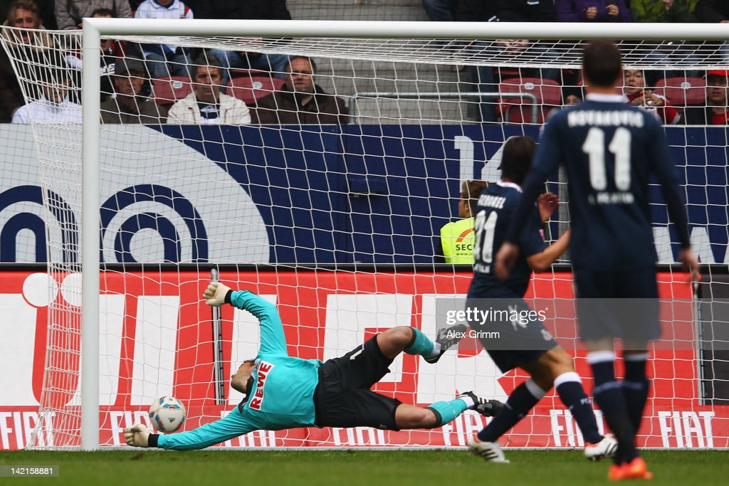 JaCheol Koo scores his team's first goal against goalkeeper Michael Rensing of Koeln during the Bundesliga match between FC Augsburg and 1 FC Koeln...