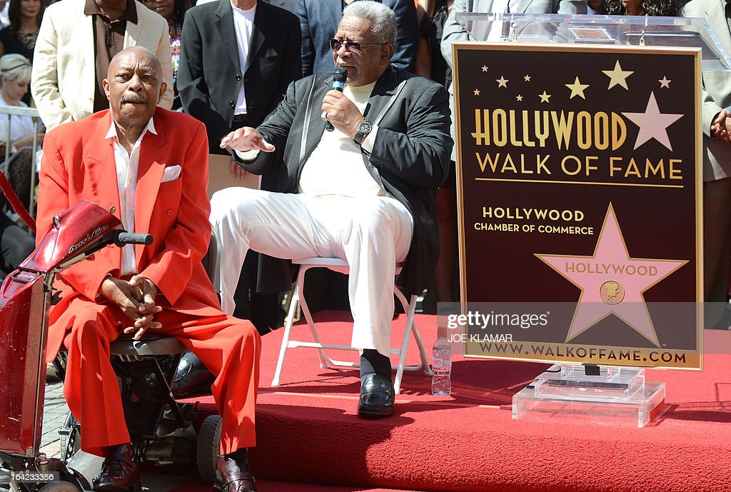 Jack Ashford (R) speaks as he and Eddie Willis (L), surviving members of the Funk Brothers, attend a ceremony honoring the musicians with a star on the Hollywood Walk of Fame on March 21, 2013 in Hollywood, California.The Funk Brothers was the nickname of Detroit, Michigan, session musicians who performed the backing to most Motown recordings from 1959 until the company moved to Los Angeles in 1972. AFP PHOTO/JOE KLAMAR