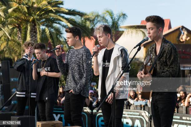 Jack Avery Zach Herron Jonah Marais Corbyn Besson and Daniel Seavey of Why Don't We perform at 'Extra' at Universal Studios Hollywood on November 14...