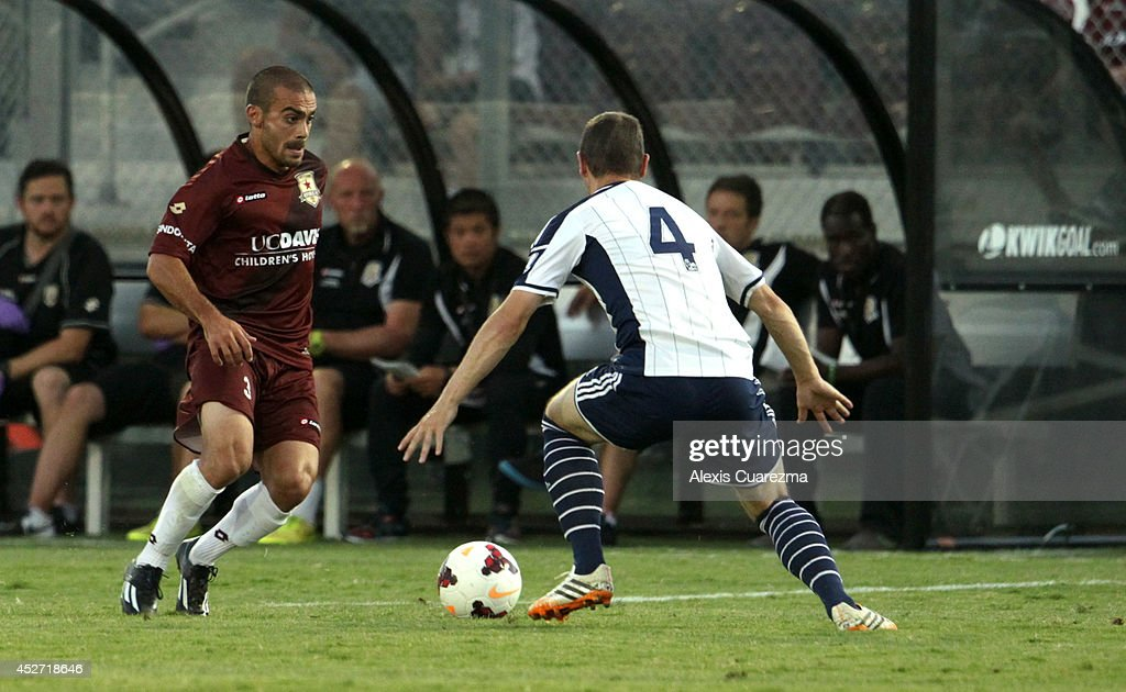 Jack Avesyan of the Sacramento Republic controls the ball as Chris Baird from West Bromwich Albion defends during the friendly match between West...