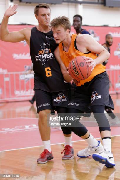 Jack Barry drives to the basket as Ryan Vines defends during the NBL Combine 2017/18 at Melbourne Sports and Aquatic Centre on April 17 2017 in...