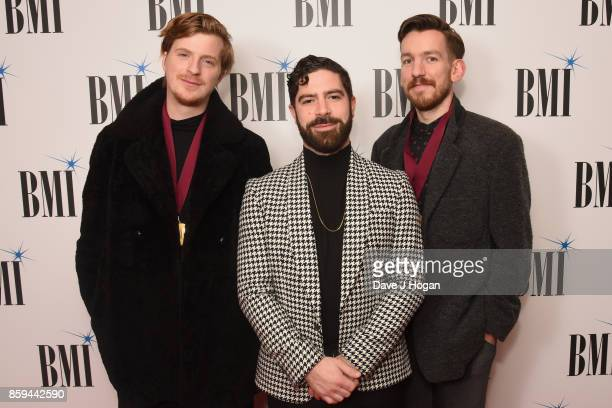 Jack Bevan Yannis Philippakis and Edwin Congreave of Foals attend the BMI London Awards at The Dorchester on October 9 2017 in London England