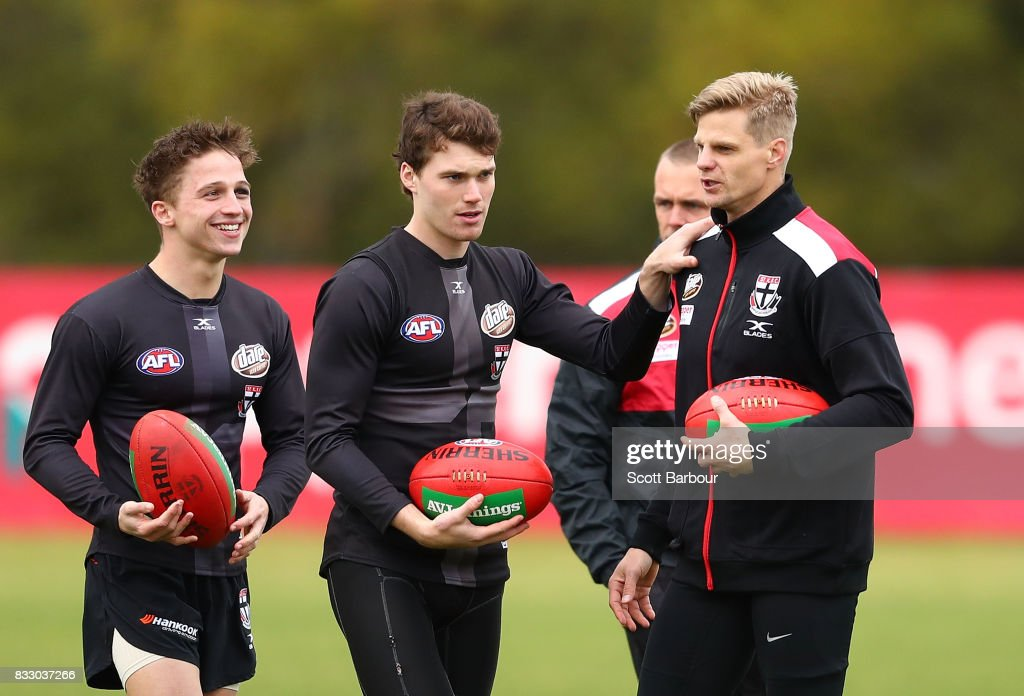 Jack Billings of the Saints, Blake Acres of the Saints and Nick Riewoldt of the Saints talk during a St Kilda Saints AFL training session at Linen House Oval on August 17, 2017 in Melbourne, Australia.