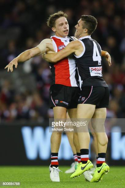 Jack Billings of the Saints celebrates a goal with Jade Gresham during the round 14 AFL match between the St Kilda Saints and the Gold Coast Suns at...
