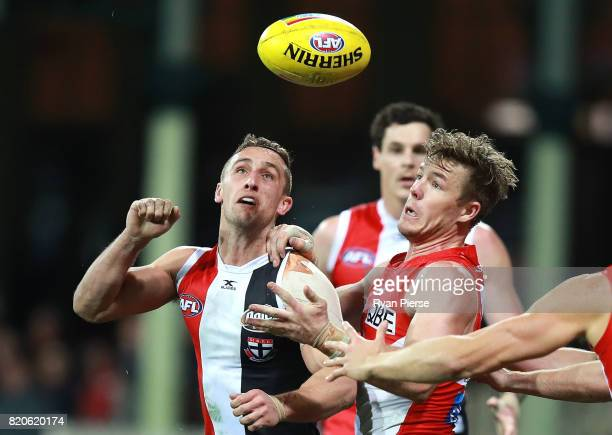 Jack Billings of the Saints competes for the ball against Luke Parker of the Swans during the round 18 AFL match between the Sydney Swans and the St...