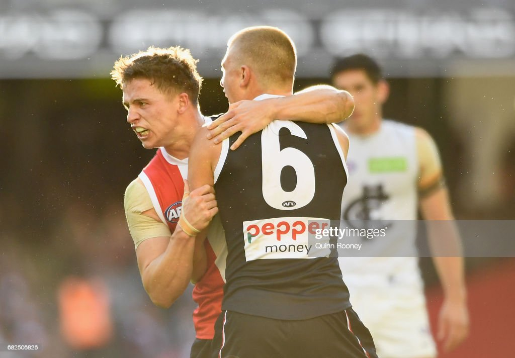 Jack Billings of the Saints is congratulated by Sebastian Ross after kicking a goal during the round eight AFL match between the St Kilda Saints and the Carlton Blues at Etihad Stadium on May 13, 2017 in Melbourne, Australia.