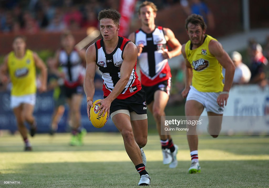 Jack Billings of the Saints looks to pass the ball during the St Kilda Saints AFL Intra-Club Match at Trevor Barker Beach Oval on February 12, 2016 in Melbourne, Australia.