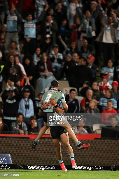 Jack Bird and Valentine Holmes of the Sharks celebrate victory during the round 10 NRL match between the St George Illawarra Dragons and the Cronulla...