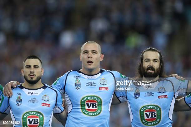 Jack Bird David Klemmer and Aaron Woods of the Blues stand and sing the National Anthem before game two of the State Of Origin series between the New...