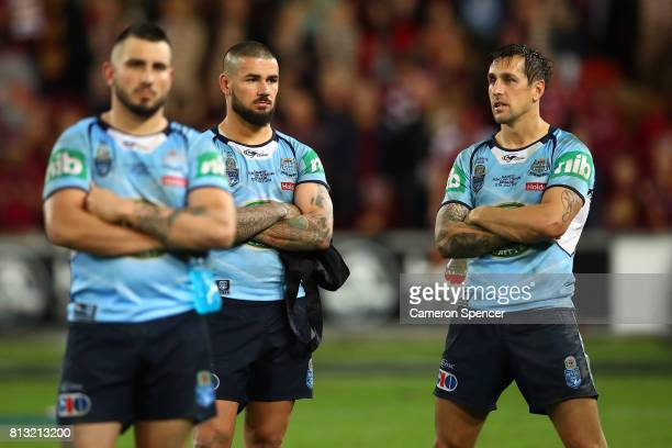 Jack Bird Nathan Peats and Mitchell Pearce of the Blues look dejected after game three of the State Of Origin series between the Queensland Maroons...