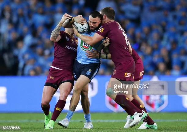 Jack Bird of the Blues is tackled during game two of the State Of Origin series between the New South Wales Blues and the Queensland Maroons at ANZ...