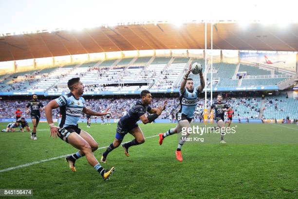 Jack Bird of the Sharks grabs the ball to score a try during the NRL Elimination Final match between the Cronulla Sharks and the North Queensland...