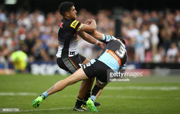 Jack Bird of the Sharks is tackled by Tyrone Peachey of the Panthers during the round seven NRL match between the Penrith Panthers and the Cronulla...