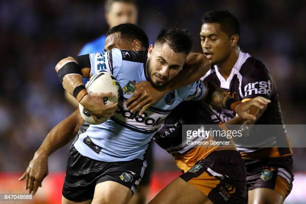 Jack Bird of the Sharks is tackled during the round one NRL match between the Cronulla Sharks and the Brisbane Broncos at Southern Cross Group...