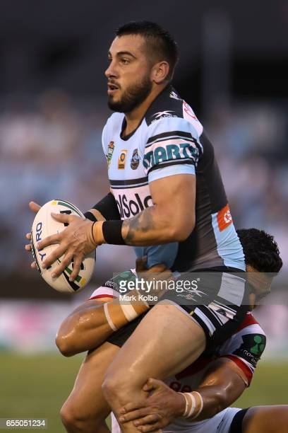 Jack Bird of the Sharks is tackled during the round three NRL match between the Cronulla Sharks and the St George Illawarra Dragons at Southern Cross...