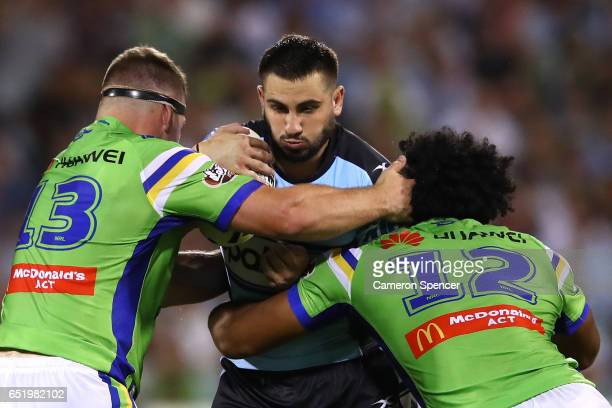 Jack Bird of the Sharks is tackled during the round two NRL match between the Canberra Raiders and the Cronulla Sharks at GIO Stadium on March 11...