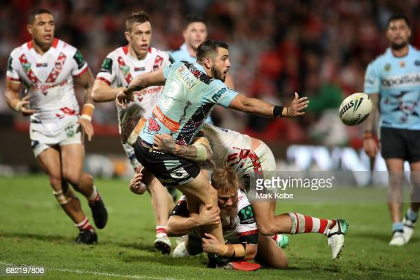 Jack Bird of the Sharks passes as he is tackled during the round 10 NRL match between the St George Illawarra Dragons and the Cronulla Sharks at UOW...