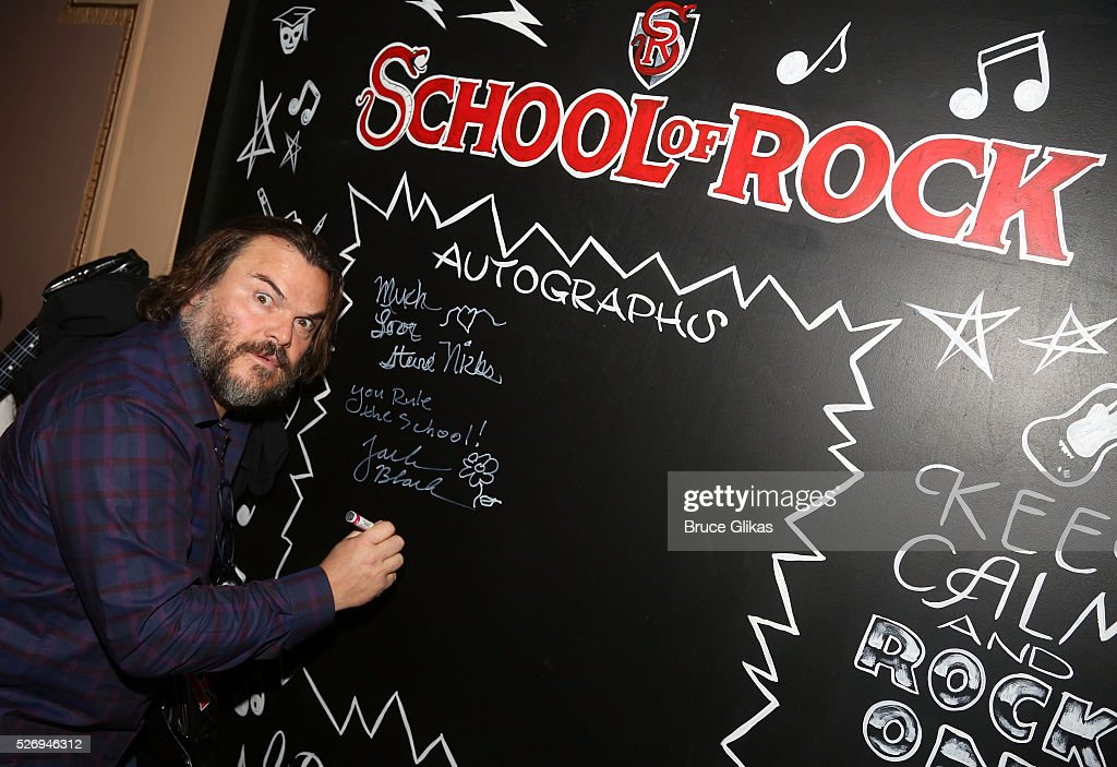 Jack Black (who starred in the fiilm as 'Dewey Finn') signs the VIP room wall backstage at the hit musical based on the film starring Jack Black 'School of Rock' on Broadway at The Winter Garden Theatre on May 1, 2016 in New York City.