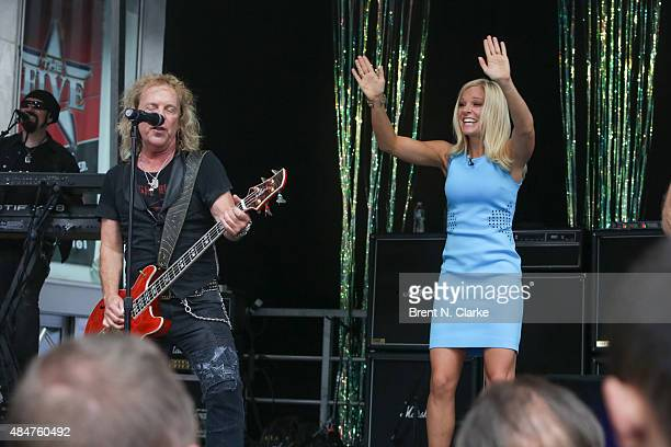 Jack Blades of the rock group Night Ranger and 'FOX Friends' cohost Anna Kooiman perform live on stage during the 'FOX Friends' All American Concert...