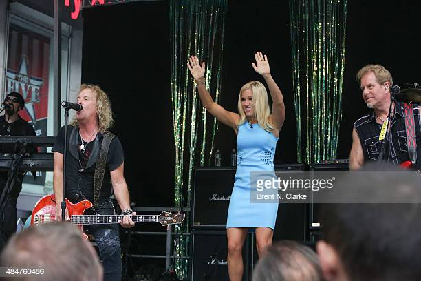 Jack Blades of the rock group Night Ranger 'FOX Friends' cohost Anna Kooiman and Night Ranger Brad Gillis perform live on stage during the 'FOX...