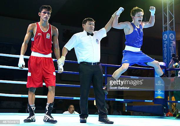 Jack Bowen of Australia celebrates defeating Gaurav Solanki of India during the Youth's Fly 52kg Boxing at the Tuanaimato Sports Facility on day four...