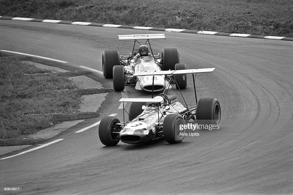Jack Brabham in his Brabham BT26 Repco briefly leads Dan Gurney's McLaren M7A in the United States Grand Prix held at Watkins Glen, New York on October 6, 1968.