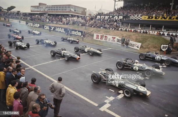Jack Brabham of Australia driving the Brabham Racing Organisation Brabham BT19 Repco 30 V8 lines up in pole position alongside team mate Denny Hulme...