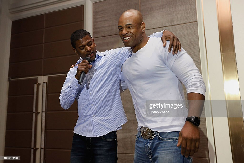 Jack Brewer (L) and former NFL player <a gi-track='captionPersonalityLinkClicked' href=/galleries/search?phrase=Akin+Ayodele&family=editorial&specificpeople=234928 ng-click='$event.stopPropagation()'>Akin Ayodele</a> deliver a speech during the official NFL China Super Bowl Party at Kerry Hotel on February 4, 2013 in Beijing, China.