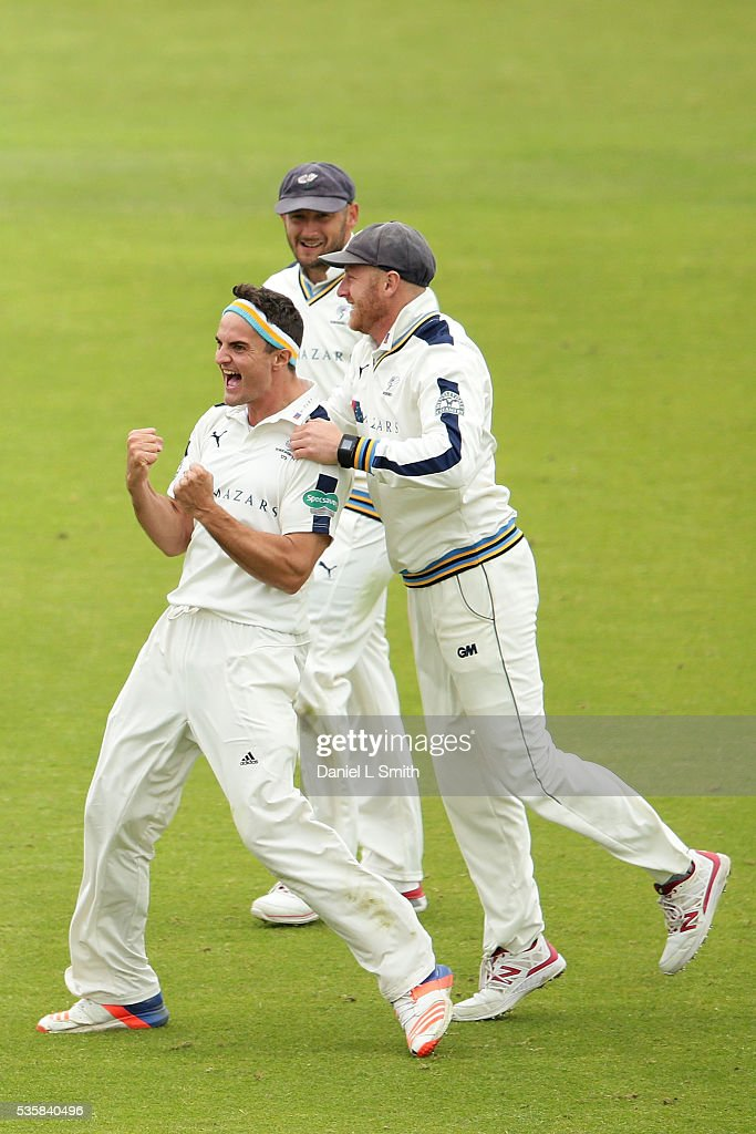 Jack Brooks and Anfrew Gale (C) of Yorkshire celebrates dismissing Alviro Petersen of Lancashire LBW during day two of the Specsavers County Championship: Division One match between Yorkshire and Lancashire at Headingley on May 30, 2016 in Leeds, England.