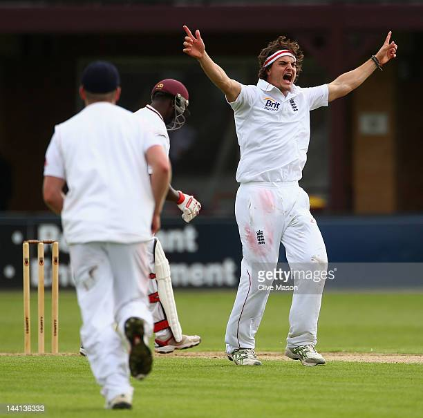 Jack Brooks of England Lions appeals sucessfully for the wicket of Kemar Roach of West Indies during day one of the tour match between England Lions...
